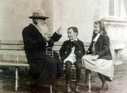 Leo Tolstoy telling fairy tales to his grandchildren, 1909.